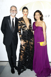 Kendall Jenner looked provocative in a see-through black gown by Longchamp during the brand's 70th anniversary celebration.