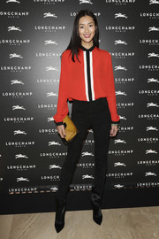 Liu Wen continued the rocker-chic vibe with a pair of black fur ankle boots.