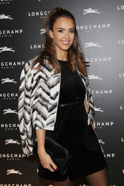 Jessica Alba arrived for the Longchamp cocktail party carrying a stylish black fur clutch from the brand.