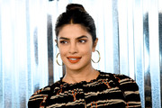 Priyanka Chopra styled her hair into a casual bun for the Longchamp Spring 2019 show.