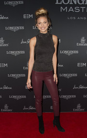 AnnaLynne McCord styled her top with a pair of burgundy leather pants.