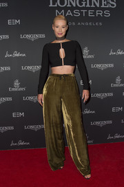 Iggy Azalea paired her sexy top with olive-green wide-leg pants.