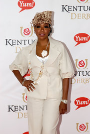 Tichina Arnold dressed up her all-white outfit with a printed decorative hat at the Kentucky Derby.