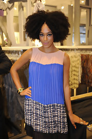 Solange paired her color-blocked pleated dress with a bold cuff bracelet.