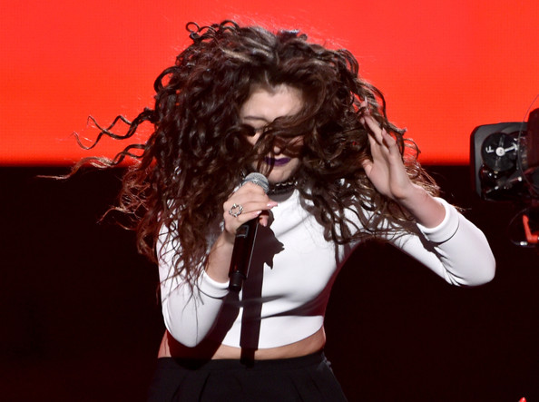 Lorde Diamond Ring [hair,music artist,red,singing,singer,hairstyle,performance,microphone,pop music,long hair,lorde,american music awards,california,los angeles,nokia theatre l.a. live,show]