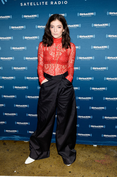 Lorde showed some skin in a sheer red lace top at the release of her new album, 'Melodrama.'