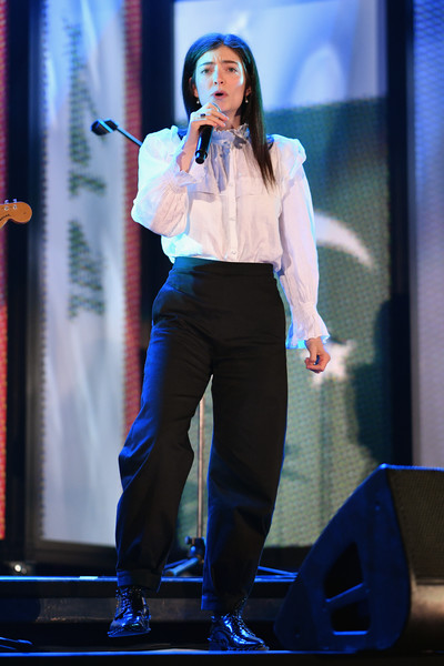 Lorde Ruffle Blouse [you are,performance,entertainment,talent show,blue,singing,performing arts,singer,stage,event,public event,lorde,christchurch stadium,new zealand,performers unite in support of christchurch for you,aroha nui concert,mosque attacks,fundraising show]