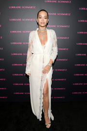 Rita Ora went boudoir-glam in a white La Perla robe gown with a lace underlay at the launch of the Eye Bangle.