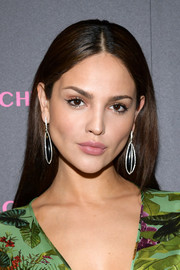 Eiza Gonzalez kept it simple and classic with this straight, center-parted hairstyle at the launch of the Eye Bangle.