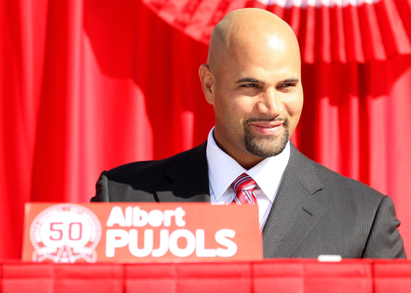 Albert Pujols signed to play for the Los Angeles Angels with a bald head.
