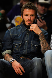 David Beckham buttons this denim top all the way up...