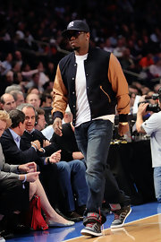 Sean Combs spruced up his plain white tee with a two-tone track jacket at the Los Angeles Clippers versus New York Knicks game.