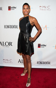Kearran Giovanni vamped it up in a strapless black leather dress at the LA Confidential pre-Emmy celebration.