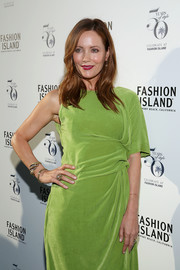 Leslie Mann teamed a duo of gold bracelets with a lime-green dress for Fashion Island's 50th anniversary celebration.