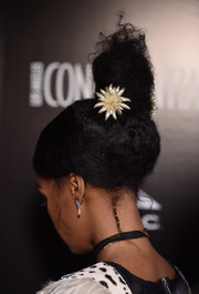 Janelle Monae styled her hair into a towering top knot for the Los Angeles Confidential Spring Oscars issue celebration.