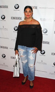 Rachel Roy contrasted her girly top with edgy ripped jeans.