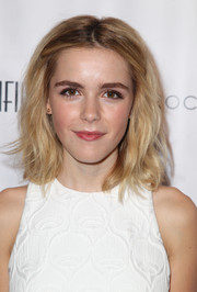 Kiernan Shipka wore her hair down to her shoulders with a center part and edgy waves during the Los Angeles Confidential Women of Influence event.