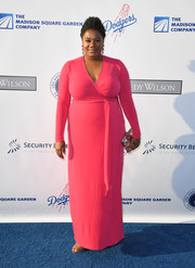 Adrienne C. Moore paired her chic dress with a colorful printed clutch.