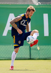 Soccer star David Beckham is a tattoo afficionado, with both arms covered in sleeves.