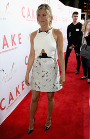 Jennifer Aniston was all sugar and spice at the 'Cake' premiere in a Giambattista Valli mini with a bowed neckline, a floral jacquard skirt, and a midriff cutout.