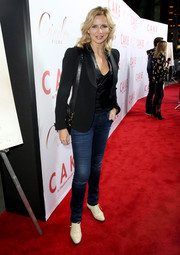 Veronica Ferres paired her jeans with a black blazer for a smarter finish.