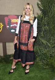 Busy Philipps paired her dress with black satin mules by Stuart Weitzman.