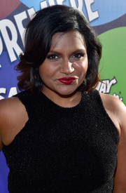 Mindy Kaling swiped on some red lipstick for a sexy pout.