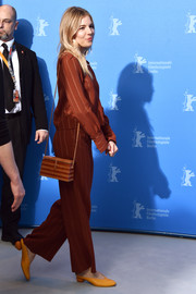 Sienna Miller headed to the Berlinale International Film Festival photocall for 'The Lost City of Z' sporting a matchy-matchy striped shoulder bag, blouse, and pants ensemble.
