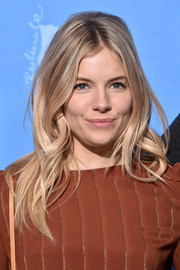Sienna Miller channeled Brigitte Bardot with this retro-chic wavy 'do at the Berlinale International Film Festival photocall for 'The Lost City of Z.'