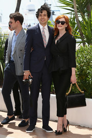 Christina Hendricks arrived for the 'Lost River' photocall carrying a super-elegant black crocodile tote.