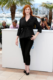 For an ultra-girly finish, Christina Hendricks styled her suit with bow-adorned black Oroton Sepia pumps.