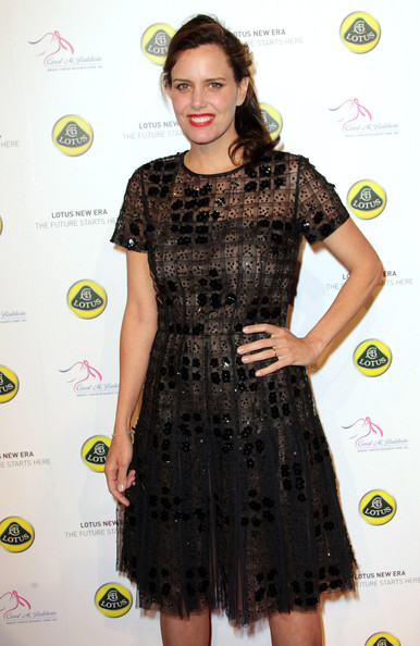Ione Skye wore a delicately beaded black dress paired with bright red lips to a launch event in LA.