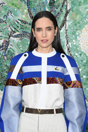 Jennifer Connelly attended the Louis Vuitton Cruise 2019 show wearing a logo leather belt from the label.