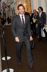 Marc looked sleek in his grey suit which he paired with a burgundy tie.