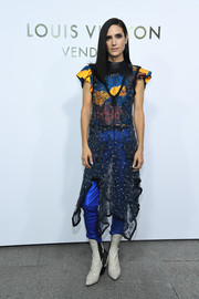 Jennifer Connelly showed off her unique style with this sheer dress layered over a printed crop-top and electric-blue pants, all by Louis Vuitton, during the brand's boutique opening in Paris.