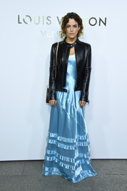 Riley Keough layered a black leather jacket over her dress for a touch of toughness.