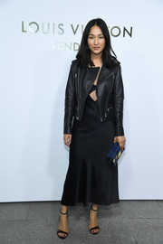 Nicole Warne toughened up her slinky cutout dress with a leather biker jacket for the Louis Vuitton boutique opening in Paris.