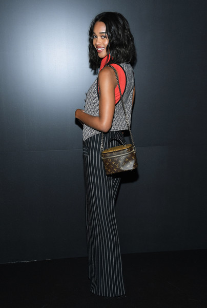 Laura Harrier attended the Louis Vuitton Fall 2020 show carrying a monogram bag from the label.