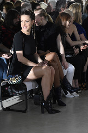 Adele Exarchopoulos sat front row at the Louis Vuitton fashion show carrying a sporty shoulder bag from the label.