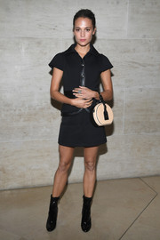 Alicia Vikander showed off her incredibly toned legs in a short black skirt suit by Louis Vuitton during the brand's Spring 2018 show.