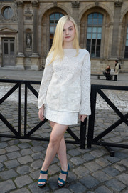 Elle Fanning looked very refined in an embroidered white blouse and a matching mini skirt during the Louis Vuitton fashion show.