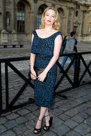 Haley Bennett was retro-chic in a blue floral dress during the Louis Vuitton fashion show.