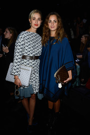 Elisabeth von Thurn und Taxis paired her frock with an oversized gray clutch.