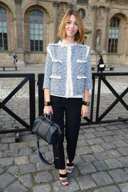 Sofia Coppola attended the Louis Vuitton fashion show looking classic in a blue tweed jacket and black slacks.