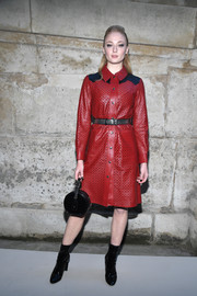 Sophie Turner was Western-chic in a perforated red leather shirtdress by Louis Vuitton during the brand's Fall 2018 show.