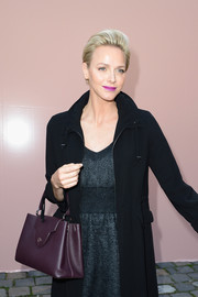 Charlene Wittstock complemented her classy outfit with an elegant plum-colored leather tote when she attended the Louis Vuitton fashion show.
