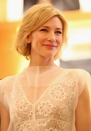 Cate Blanchett wore her subtly layered bob with soft waves and side-swept bangs at the Louis Vuitton Maison Australia press conference.