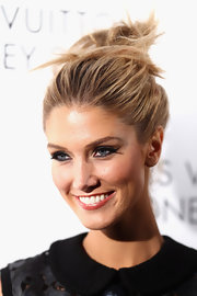 Delta Goodrem wore her hair in a sleek updo at the Louis Vuitton Maison reception.