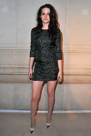 Kristen Stewart looked edgy at the Louis Vuitton exhibit in Paris wearing this leopard print dress.