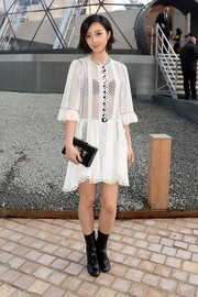 Gwei lun Mei paired her LWD with retro-chic black mid-calf boots, also by Louis Vuitton.